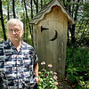 Record-Eagle/Keith King<br /> Bill Councell, of Lake Ann, stands next to an outhouse, which has been on his property for approximately nine years, as a storage space.