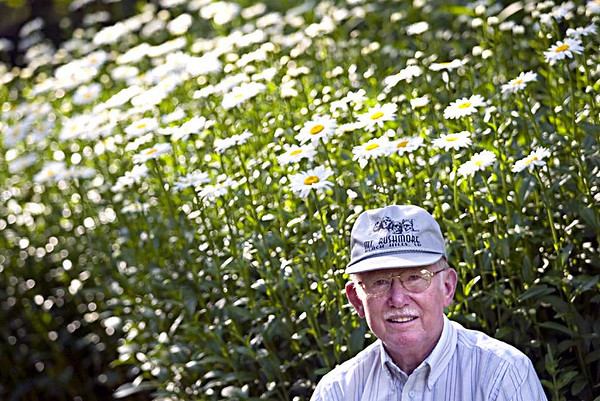 Record-Eagle/Jan-Michael Stump<br /> Bob LeRoy started building a garden on either side of the driveway of his Lake Ann home about six years ago, but has added a lot to in the past two years.