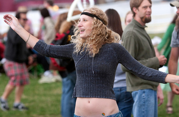 "Record-Eagle/Douglas Tesner<br /> Lanae Sambrano-Bartz  gets into a 60s mood as she dances to music in the Open Space before the showing of the movie ""Hair."""
