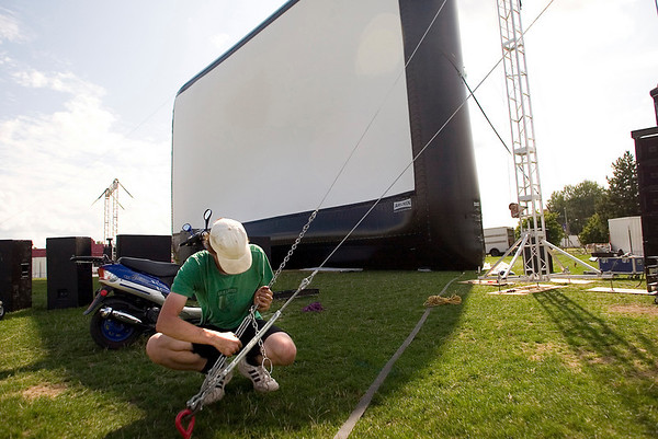 Record-Eagle photo/Jan-Michael Stump<br /> Nate Nichols prepares scaffolding for speakers next to the big screen at the Open Space for the Traverse City Film Festival, which opens today. Nightly movies at the Open Space are free and begin at dusk.