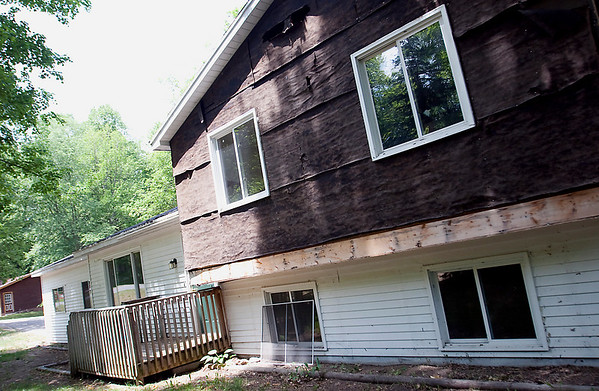 Record-Eagle/Douglas Tesner<br /> The  former owner of a home located at 135  Bluejay in East Bay Township  gutted  and  removed  most of the siding  from the house just before it was foreclosed on.