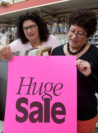 Record-Eagle/Douglas Tesner<br /> Patricia DeYoung, right, and daughter Dawn prepare for a liquidation sale at DeYoung's Arts Supplies & Framing in downtown Traverse City.