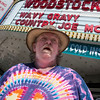 "Record-Eagle/Douglas Tesner<br /> Marc Ryan, 58, waits for the showing of ""Woodstock"" at the State Theatre. The film was the first movie shown at this year's film festival."