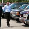 "Record-Eagle/Douglas Tesner<br /> Gov. Jennifer Granholm walks down a line of ""clunkers"" at Saturn of Traverse City on U.S. 31. They were traded in for new cars under the federal ""Cash for Clunkers"" program."