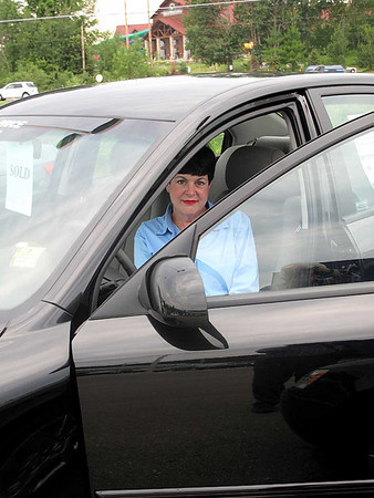 """Record-Eagle/Bill O'Brien<br /> Susanelou Adair shows off her new Hyundai she purchased with help from the federal government's Car Allowance Rebate Systems (CARS) program, also known as """"Cash for Clunkers."""" Area car dealers said the incentive, up to $4,500, is spurring interest among consumers."""