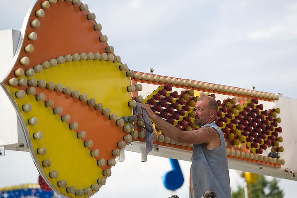 Record-Eagle photo/Jan-Michael Stump<br /> Leon Howell cleans up the 1001 Nights ride on the Harbor Days midway. The Elk Rapids festival starts Wednesday.