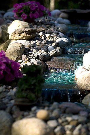 Record-Eagle/Jan-Michael Stump<br /> A waterfall runs through Bob LeRoy's Lake Ann garden.