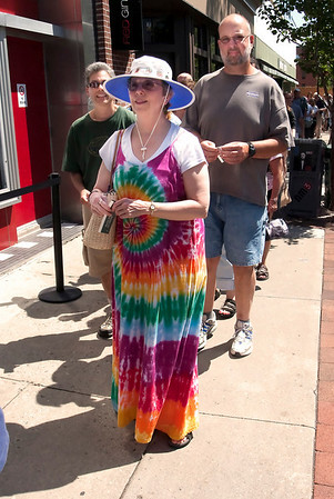 "Record-Eagle/Douglas Tesner<br /> Pat Light, 66, waits in line for the matinee showing of ""Woodstock: The Director's Cut"" Tuesday at the State Theatre."