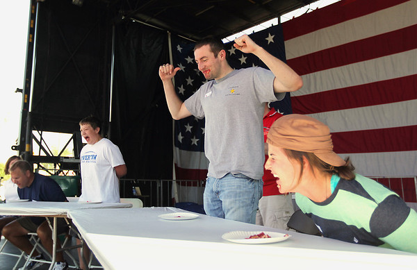 Record-Eagle/Keith King<br /> Jim Kratus, of Dallas, TX, stands up next to Lisa Ordway, of Denver, CO, after winning a heat as they compete Friday, July 8, 2011 in the Adult Cherry Pie Eating Contest during the National Cherry Festival.