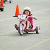 Record-Eagle/Keith King<br /> McAra Sovis, 6, of Traverse City, pedals toward the finish line for a first-place finish in her age division during the Kids'Big Wheel Race. Sovis also won first place in her division when she was 4 years old and 5 years old.