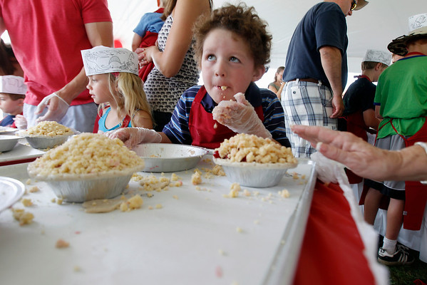 Record-Eagle/Jan-Michael Stump<br /> Mason Cox, 4, of Traverse City samples the crumb topping while making his own cherry pie at the Grand Traverse Pie Make and Bake Thursday during the National Cherry Festival.