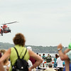Record-Eagle/Keith King<br /> Members of the United States Coast Guard Airstation Traverse City perform a demonstration over West Grand Traverse Bay on Saturday as part of the National Cherry Festival Air Show.