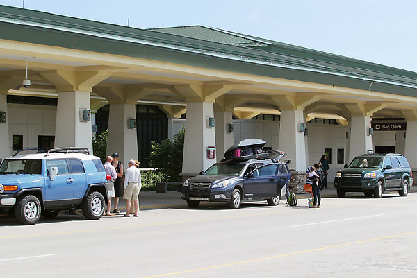 Record-Eagle/Keith King<br /> Automobiles park as travelers exit Cherry Capital Airport.