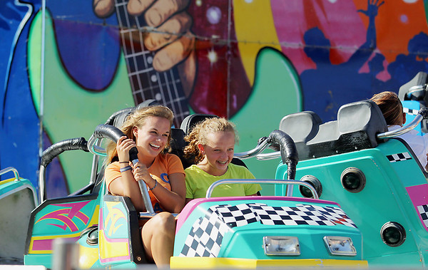 Record-Eagle/Keith King<br /> Brianna Borrello, left, 16, and her sister, Elsa Borrello, 13, ride the Crazy Dance ride Friday, July 8, 2011 at the Arnold Amusements Midway during the National Cherry Festival.