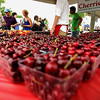 Record-Eagle/Keith King<br /> Cherries from Edmondson Orchards are sold near the Open Space on Saturday during the opening day of the National Cherry Festival.