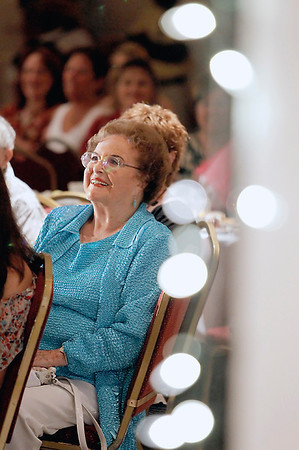 Record-Eagle/Jan-Michael Stump<br /> Former Mrs. Traverse City, Mrs. Michigan and Mrs. America Elizabeth Stokes Witteveen watches the National Cherry Festival Royale Pageant of Fashion Wednesday at the Park Place Dome.