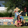 Record-Eagle/Jan-Michael Stump<br /> Michele Paulie of Traverse City and her daughter Ella, 4, hang out outside the Cherry Connection: Bringing Together Festival, Farm and Fruit Friday at the Northwest Michigan Horticultural Research Station operated by Michigan State University.
