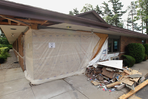 Record-Eagle/Keith King<br /> Debris and damage are visible on Tuesday at the Social Security Office on Munson Avenue.