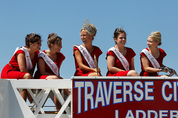 Record-Eagle/Jan-Michael Stump<br /> Cherry Queen Maria LaCross, center, laughs with  2011 candidates, from left, Jordan Blaker, Laura Patmore, Stephanie Neville and Evelynne Mende during a photo shoot on top of Traverse City Fire Department's Ladder 1 truck during Heroes' Day Monday at the National Cherry Festival.