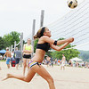Record-Eagle/Keith King<br /> Katherine Oetjens, of Traverse City, runs down the ball as she competes Saturday in the Two-Person Beach Volleyball Tournament near West End Beach.