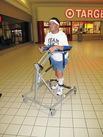 Record-Eagle/Jodee Taylor<br /> Grant Forrester, of Traverse City, walks at the Grand Traverse Mall. Forrester, a quadriplegic, plans to walk the 5K in Saturday's Festival of Races, part of the National Cherry Festival.