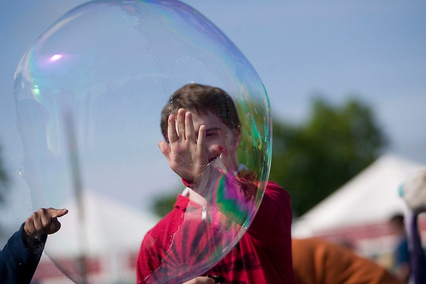 "Record-Eagle/Jan-Michael Stump<br /> Sam Walczak plays with bubbles during Fun and Games for Special Kids at the Open Space Wednesday at the National Cherry Festival. ""I don't know if we're going to leave,"" said his step-father David Byington."