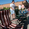 Record-Eagle/Douglas Tesner<br /> At 9:30 a.m., Dominik Baker, 11, checks his street-side lawn chairs he put in place for the Touchstone Energy Junior Royals Parade that would be starting some nine hours latter.