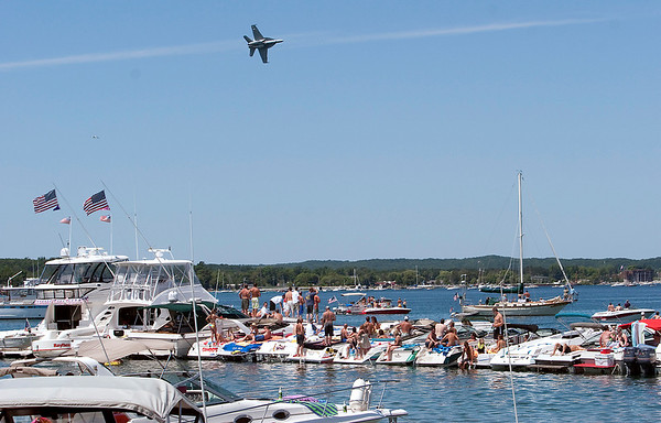 Record-Eagle/Douglas Tesner<br /> Boaters at West End Beach had a clear view of a U.S. Navy F-18 Super Hornet during the National Cherry Festival air show.