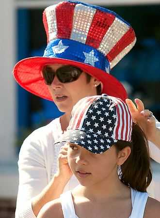 Record-Eagle/Douglas Tesner<br /> Abigale Vomastek has her hat straightened by her mother Tamara before the start of the Fourth of July parade in Frankfort.  The Vomastek family, from Traverse City, has attended the parade in Frankfort for the last seven years.