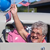 Record-Eagle/Douglas Tesner<br /> Joan Gilbert gives a smile and wave from her husband's 1930 Model T Coupe during the Fourth of July celebration in Frankfort.