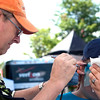 Record-Eagle/Douglas Tesner<br /> Ray Brandt gives an airbrush tattoo to Jazzie Coon at the National Cherry Festival.  A wide variety of vendors could be found on the Cherry Festival grounds.