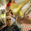 Record-Eagle/Jan-Michael Stump<br /> Winnie Young listens to Northwind Brass during the National Cherry Festival Intergenerational Picnic Wednesday at the Grand Traverse Pavillions.
