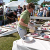 Record-Eagle/Douglas Tesner<br /> Denise Busley, of the Grand Traverse Pie Company, sets up cherry pies in the Open Space.