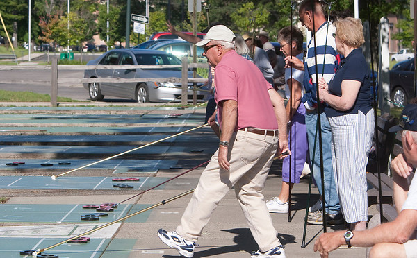 Record-Eagle/Douglas Tesner<br /> Seniors showed off their skills in the Shuffleboard Tournament at the Traverse City Senior Center as part of the National Cherry Festival. More then 32 seniors participated.