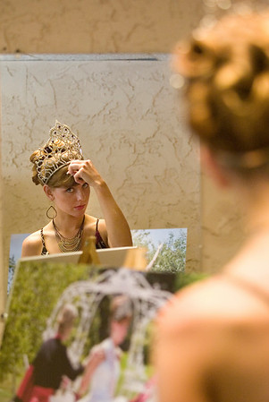 Record-Eagle/Jan-Michael Stump<br /> Cherry Queen Mgan Umulis prepares to take the runway backstage during the National Cherry Festival Royal Pageant of Fashion Wednesday at the Park Place Dome.
