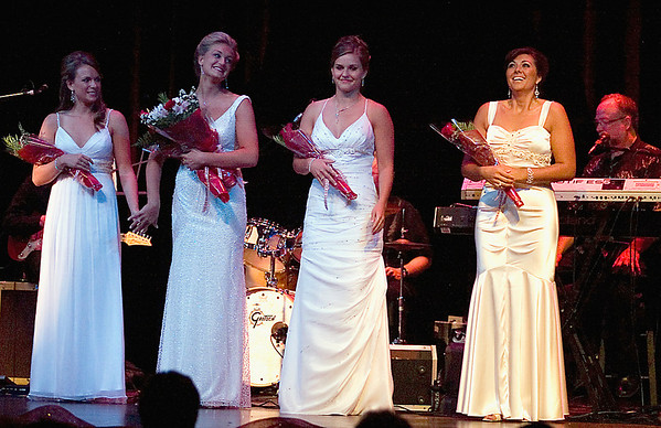 Record-Eagle/Jan-Michael Stump<br /> Angela Sayler, far right, was named 2009 National Cherry Queen Friday during the Queen's Coronation Ball and Royale Auction at the Traverse City Opera House. From left and Samantha Dunn, runner-up Stephanie Paulosky, Franki Price and Sayler.