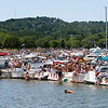 Record-Eagle/Douglas Tesner<br /> Hundreds of boats jam the shoreline near West End Beach on opening day of the National Cherry Festival.