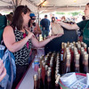 Record-Eagle/Douglas Tesner<br /> Hannah Roman waits on customers at the Gallaghers Farm Market booth. According to Roman, business was very good on opening day of the National Cherry Festival.