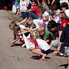Record-Eagle/Douglas Tesner<br /> Kids grab candy thrown from floats during the Fourth of July parade in Frankfort.