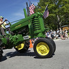 Record-Eagle/Garret Leiva<br /> A 1944 John Deere Model B owned by Phil Potrafka, of Traverse City, motors through downtown Lake Ann during the annual Lake Ann Homecoming parade Saturday in the Benzie County village. The parade featured numerous vintage tractors, classic autos and horses. Other Homecoming events included pony rides, children's games, live music, a dunk tank and tractor-powered hay wagon rides.
