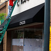 Record-Eagle/Jan-Michael Stump<br /> Dean Rinas, of Midway Signs, installs lettering at the new Chicos store at 225 E. Front St. in downtown Traverse City that opens Monday. Chico's is a women's clothing and apparel chain with more than 1,000 specialty stores around the U.S., and the new Traverse City location is part of an aggressive expansion plan to open 110 new stores. The Florida-based retailer also is slated to open a store in Birch Run this summer and a shop in Ann Arbor next year.