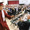Record-Eagle/Keith King<br /> Peter Mustard, left, exchanges a high five with Dr. K. Patrick Rode, who retired last year as Traverse City Christian School principal and administrator and who delivered this year's commencement address.