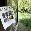 Record-Eagle/Keith King<br /> A flier with photos of Carly Lewis is posted Tuesday near trails at the Grand Traverse Commons.
