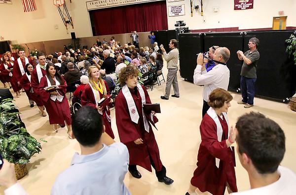 Record-Eagle/Keith King<br /> Traverse City Christian School graduates exit the gymnasium Saturday after the Traverse City Christian School graduation ceremony.