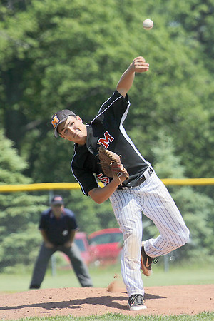 Record-Eagle/Keith King<br /> Mancelona's Taylor Borst pitches in the Division 3 quarterfinal against Muskegon Oakridge.