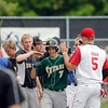 Record-Eagle/Jan-Michael Stump<br /> Traverse City West's Ben Casciano (7) is congratulated by teammates after his two-run home run put Team Near up 6-3 in the eighth inning of Wednesday's Near/Far All-Star Game. Team Near won 6-4.