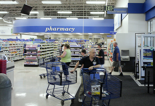 Record-Eagle/ Keith King<br /> As a result of the recently completed renovations at Meijer in Traverse City, the pharmacy department has been moved closer to the doors at the front of the store. Customers enter the store Friday.