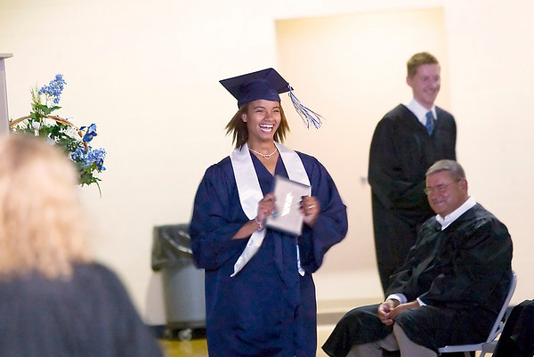 Record-Eagle/Jan-Michael Stump<br /> Grand Traverse Academy graduate Rachel Zeppa smiles after receiving her diploma during Friday's commencement exercises in the gymnasium.