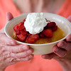 Record-Eagle/Jan-Michael Stump<br /> Carolyn Wolgamott shows off the Hot Water Sponge Cake.