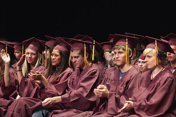 Record-Eagle/ Keith King<br /> Traverse City High School seniors applaud at the start of their graduation ceremony in Milliken Auditorium.